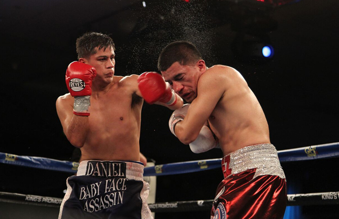 Danny Roman stopping Adam Lopez. Photo Credit: Tom Casino / Showtime