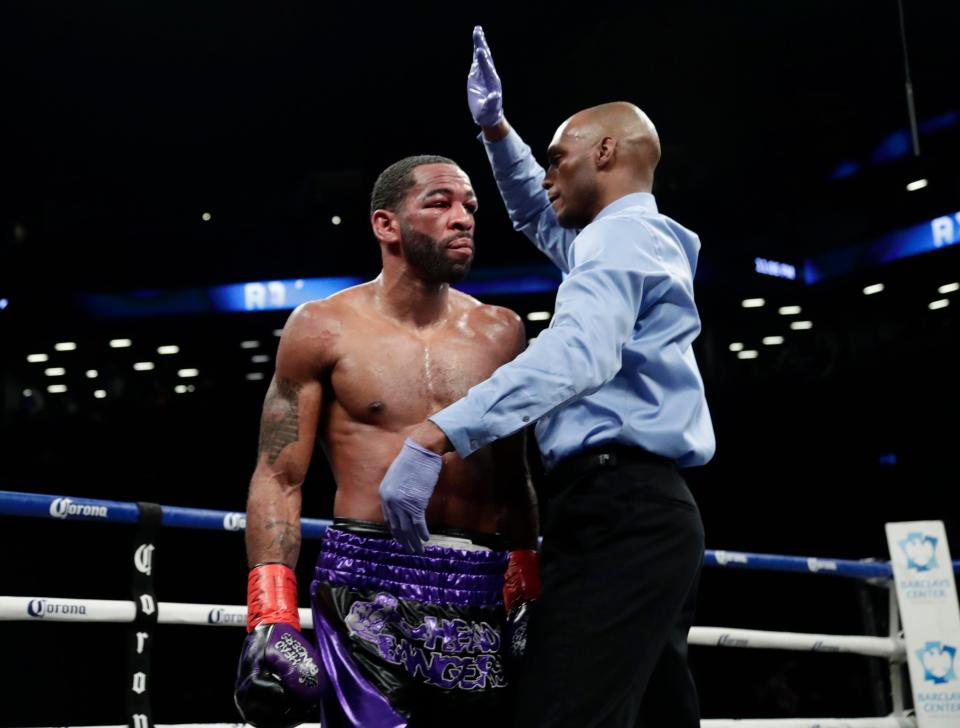 Referee calls the fight off in round 8 after Peterson's corner throw the towel in. Photo Credit: Associated Press, AP