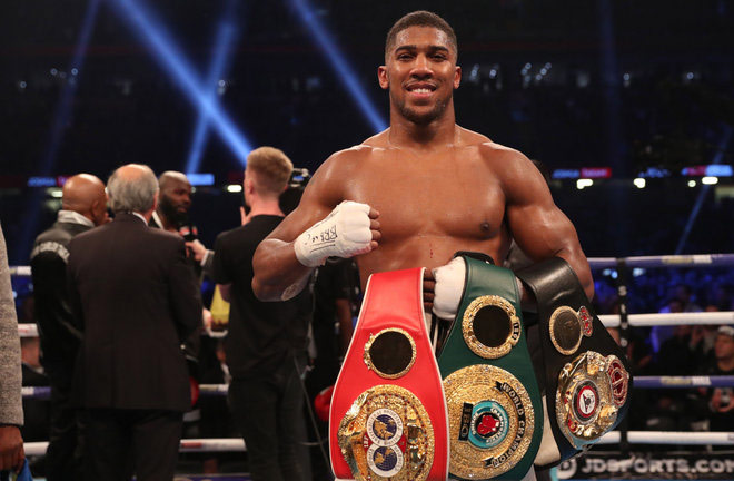 Anthony Joshua - holding his World Titles