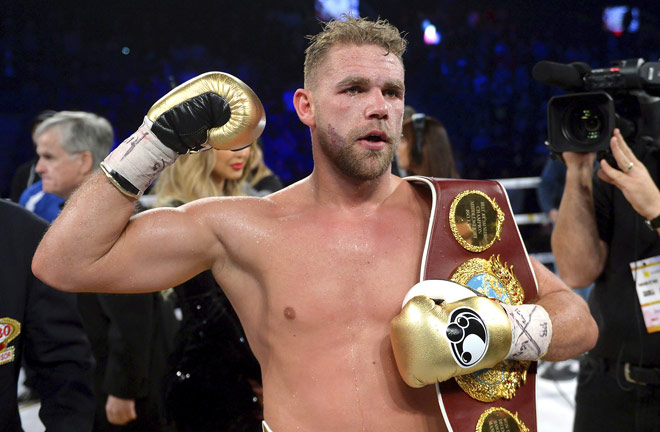 Billy-Joe-Saunders holding his IBO Title belt