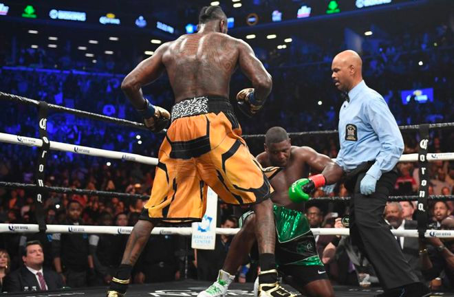 Round 10: Wilder put Ortiz to the floor three times resulting in the referee calling the fight to an end.