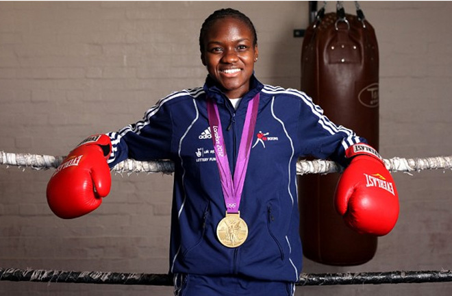 Nicola Adams signs with Steve Goodwin. Photo Credit: The Telegraph