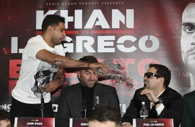 Khan throws a glass of water on Lo Greco during the Press Conference. Photo Credit: The Ring Magazine