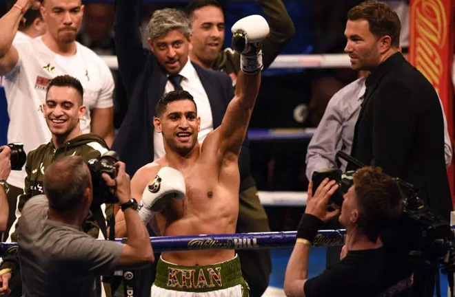 Amir Khan produced a boxing class on Saturday night. Photo Credit: The Sun