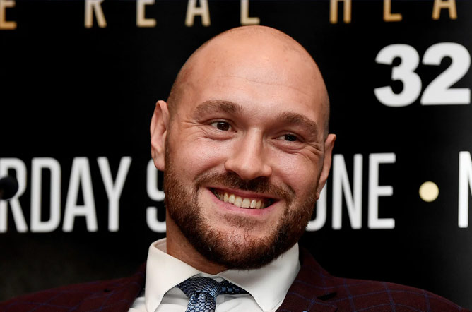 Tyson Fury announcing his return to the ring with Frank Warren. Photo Credit: The Independent Newspaper.