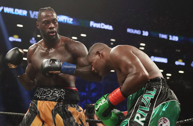 Wilder producing a devastating knockout on Luiz Ortiz. Photo Credit: Bad Left Hook