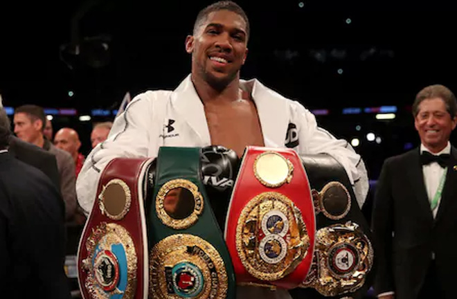 Anthony Joshua celebrates with his belts after victory over Joseph Parker. Photo Credit: The Telegraph
