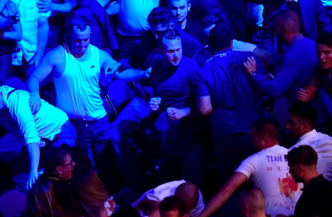 A brawl broke out in the crowd during the second round which appeared to distract fury. Photo Credit: The Sun.