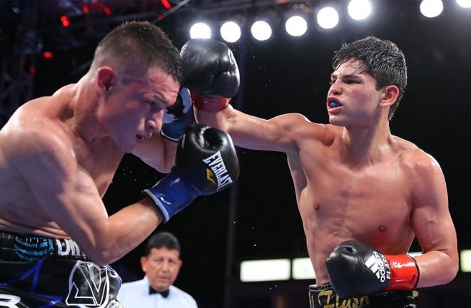 Ryan Garcia in action against Jayson Velez. Photo Credit: Boxing News