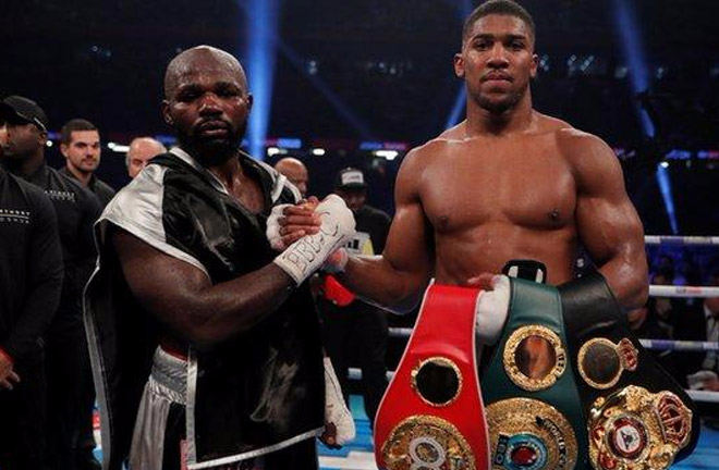 Anthony Joshua stopped Carlos Takam in round 10 to defend IBF and WBA titles. Photo Credit: MyJoyOnline.com