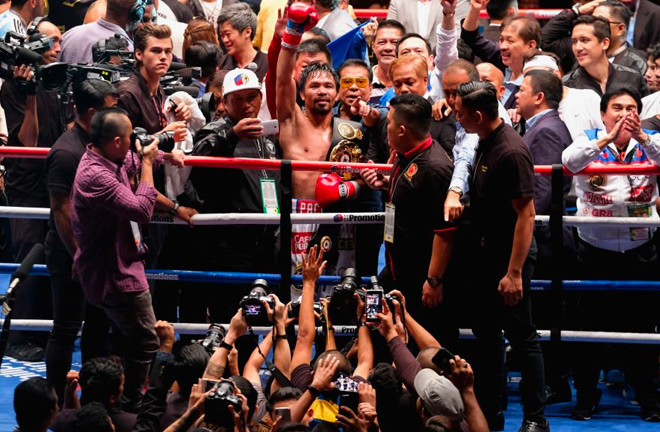 Manny Pacquiao celebrates his TKO victory over Lucas Matthysse.