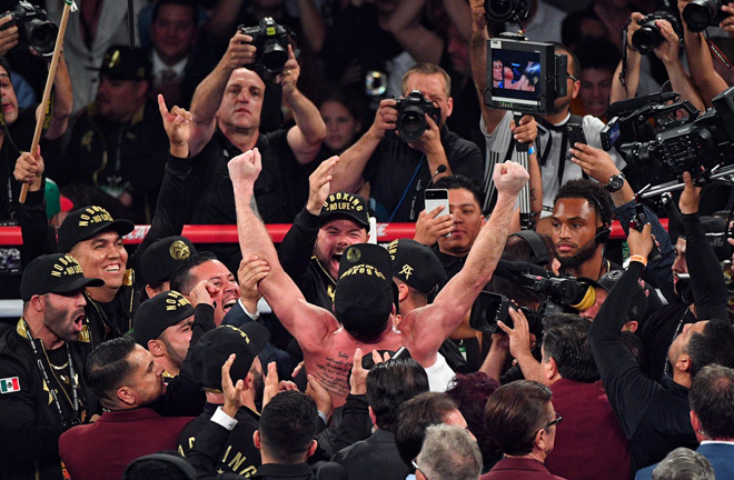 Canelo rejoiced with his team as the decisions were announced.Photo Credit: Twitter - @PowersImagery.