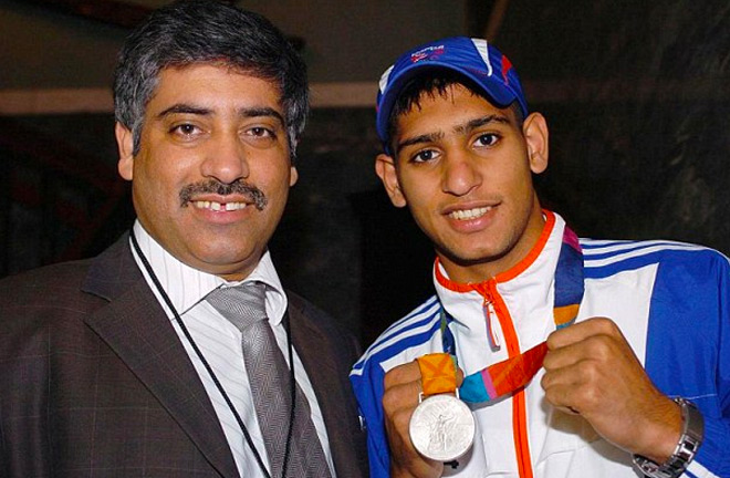 Amir Khan with his father, Shah, showing off his Silver Olympic Medal in 2004.
