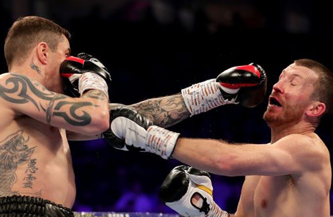 Ricky Burns floored Scotty Cardle in the third round.