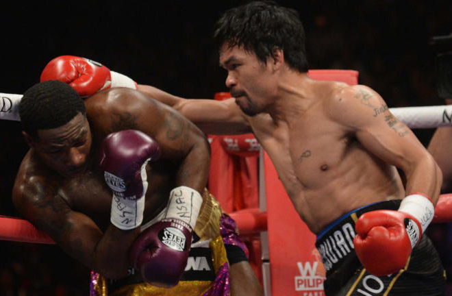 Pacquiao dominated most of the fight with the cleaner shots. Photo Credit: CBS Sports