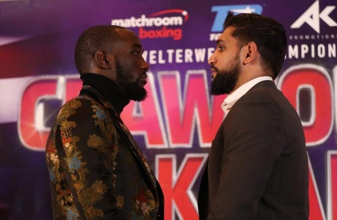 Khan-Crawford face off. Credit: The Ring Magazine