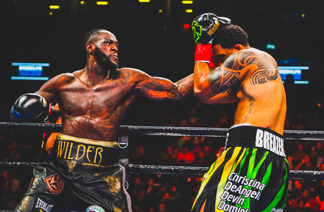 Deontay Wilder defeats Dominic Breazeale in first round.