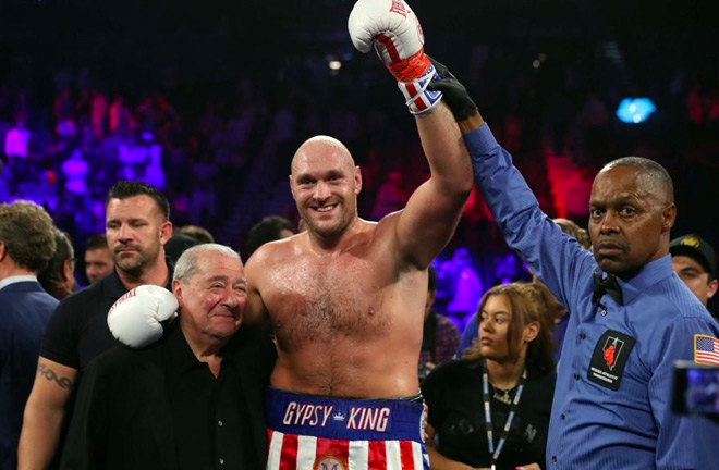 Tyson Fury with Bob Arum after being announced as the winner of the tie.