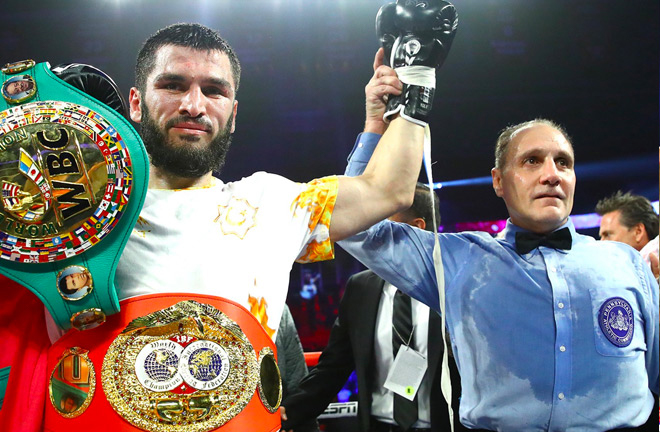 Artur Beterbiev became unified light-heavyweight champion after stopping Oleksandr Gvozdyk in Philadephia Credit: Top Rank