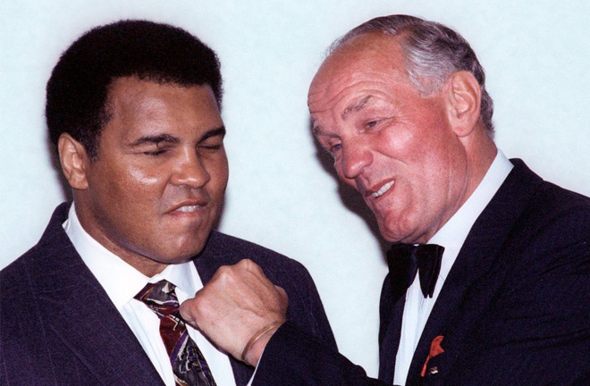 Muhammad Ali and Henry Cooper. Photo credit: nytimes.com