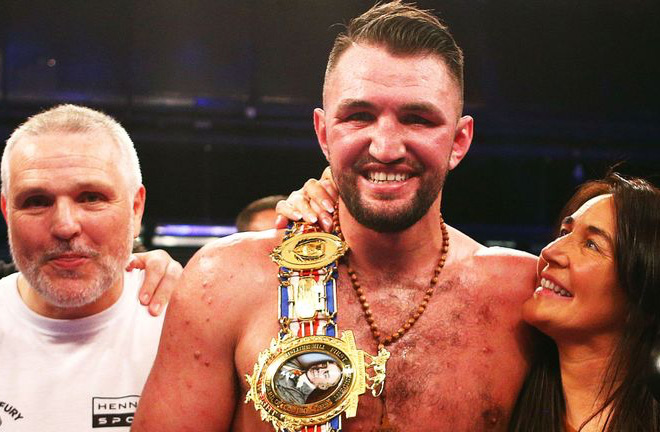 Hughie Fury flanked by his parents. Photo credit: skysports.com