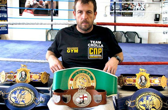Joe Gallagher with titles won by his fighters. Photo credit: manchestereveningnews.co.uk