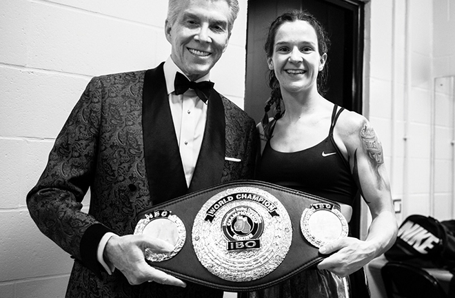 Unbeaten Terri Harper poses with Michael Buffer after defending her IBO Super Featherweight crown Credit: Matchroom Boxing
