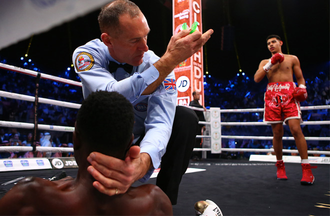 The referee moves Diego Pacheco away after he scored an emphatic 1st round knockout of Tanzania's Selemani Saidi. Photo Credit: Mark Robinson/Matchroom Boxing.