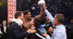 Joshua was joined by promoter Eddie Hearn as he celebrated his rematch win over Ruiz Jr Credit: Matchroom Boxing