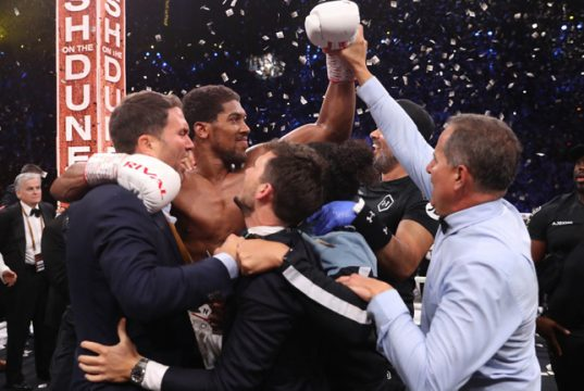 Joshua was joined by promoter Eddie Hearn as he celebrated his rematch win over Ruiz Jr in Saudi Arabia Photo Credit: Mark Robinson/Matchroom Boxing