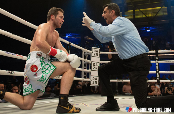 Luke Keeler taking a knee gathering his bearings during a knockdown. Photo Credit: www.proboxing-fans.com