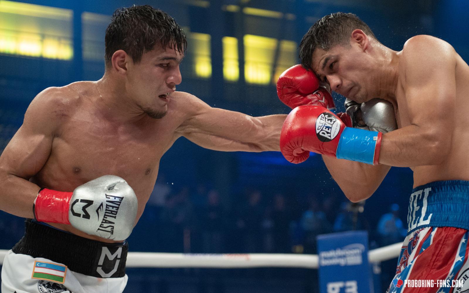 Murodjon Akhmadaliev takes two belts with split decision win over Daniel Roman. Photo Credit: www.proboxing-fans.com