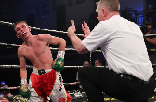 Vladislavs Davidaitis receiving a count from the referee and being dropped by Dixon. Photo Credit: Sky Sports.