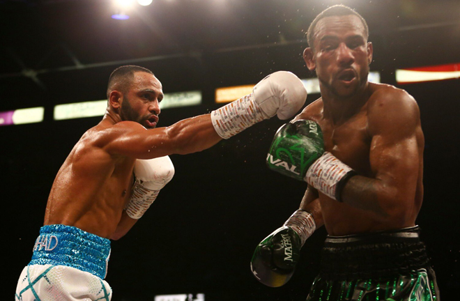 Kid Galahad wobbling his opponent in the sixth round.