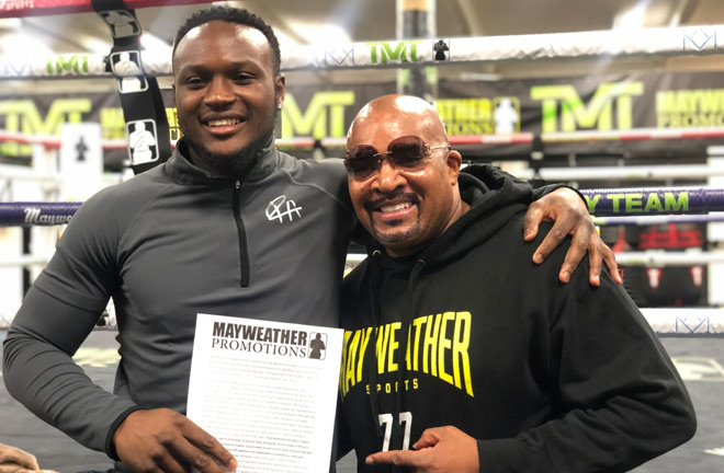 Viddal Riley with Leonard Ellerbe after signing a promotional deal with Mayweather Promotions. Photo Credit: Mayweather Promotions.