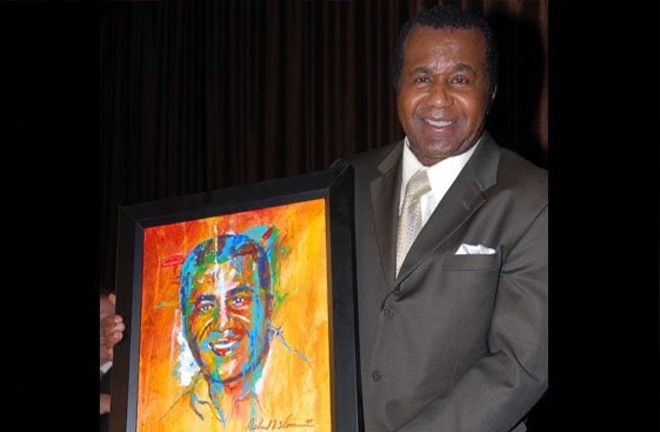 Emanuel Steward looking proud with his portrait by Richard T Slone. Photo Credit: @SloneArt Twitter