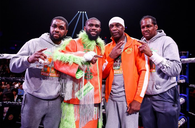 Ennis celebrates with his team after his 25th straight victory in Atlantic City Credit: Boxing Scene