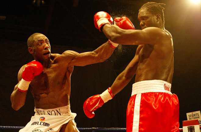 Johnny Nelson duding the heat of the battle. Photo Credit: The Mirror.