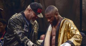 Derrick Osaze receiving the Ultimate Boxxer golden robe from Shannon Briggs. Photo Credit: London News Online