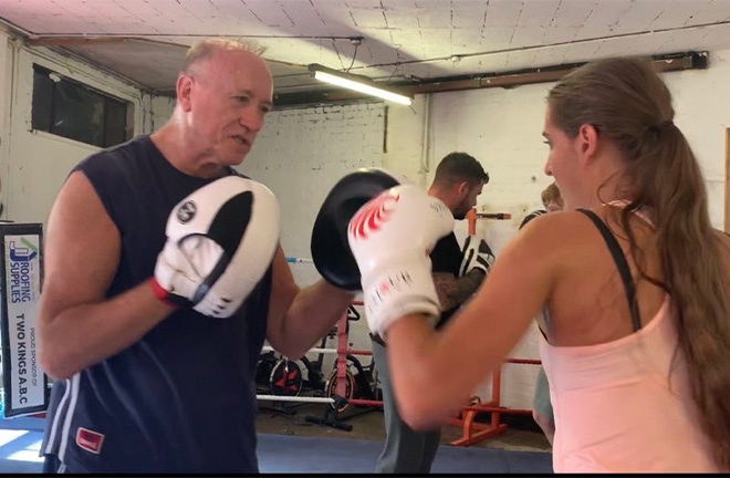 Whitney Clark on the pads with her coach at the Two Kings gym. Photo Credit: Whitney Clark.