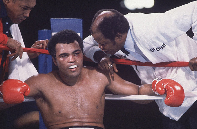 A dominated Muhammad Ali after facing Larry Holmes. Photo Credit: Sporting Illustrated