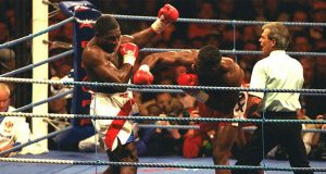 Lewis stopped British rival Frank Bruno in their WBC heavyweight title clash in Cardiff in 1993 Photo Credit: The Telegraph