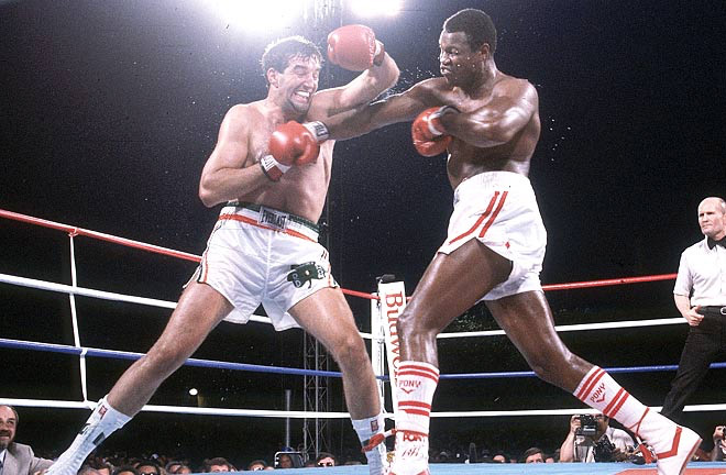Larry Holmes facing Gerry Cooney in a bout that saw both men received their highest payday. Photo Credit: The Fight City