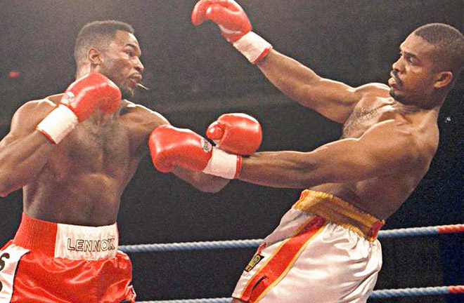 Lennox Lewis demolished 'Razor' Ruddock. Photo Credit: Boxing News