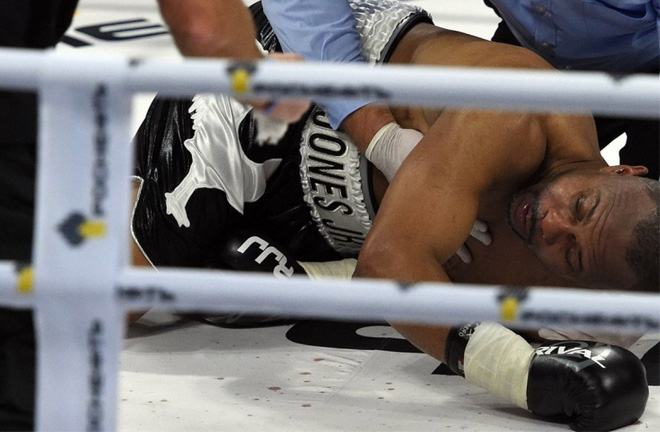 Jones Jr, a beaten man upon the canvas at the hands of Maccarinelli. Photo Credit: Irish Times