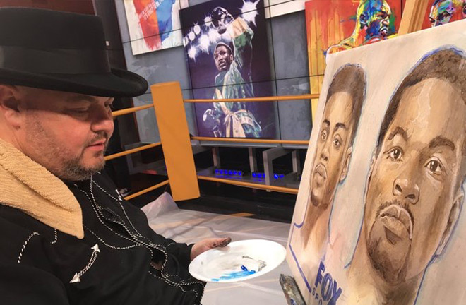 Slone in his new profession, painting, with his painting of his brother, Joe Frazier in the distance. Photo Credit: Richard T Slone