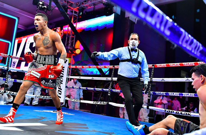 Berchelt could not hide his elation after scoring a first round knockdown on route to a sixth round win Photo Credit: Zanfer Promotions