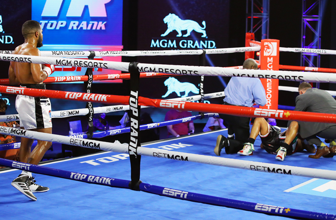 Vicente was deducted points for low blows and illegal knockdowns before being disqualified Photo Credit: Mikey Williams/Top Rank