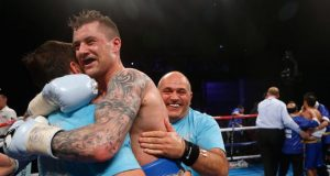 Ricky Burns celebrating a win with Tony and Peter Sims. Photo Credit: Glasgow Live