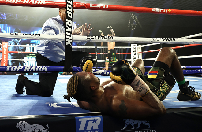Alvarez was sent through the ropes after a combination from Smith to end the fight in the ninth Photo Credit: Mikey Williams/Top Rank